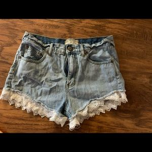 Free people jean shorts with lace